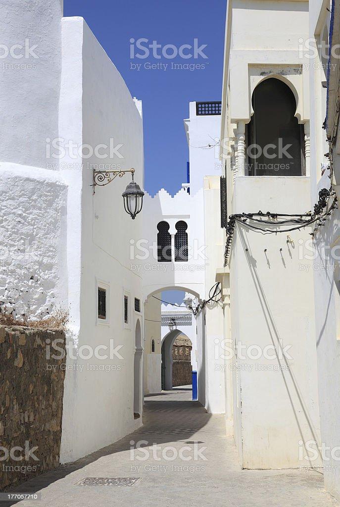 Street in the medina of Asilah, Morocco royalty-free stock photo