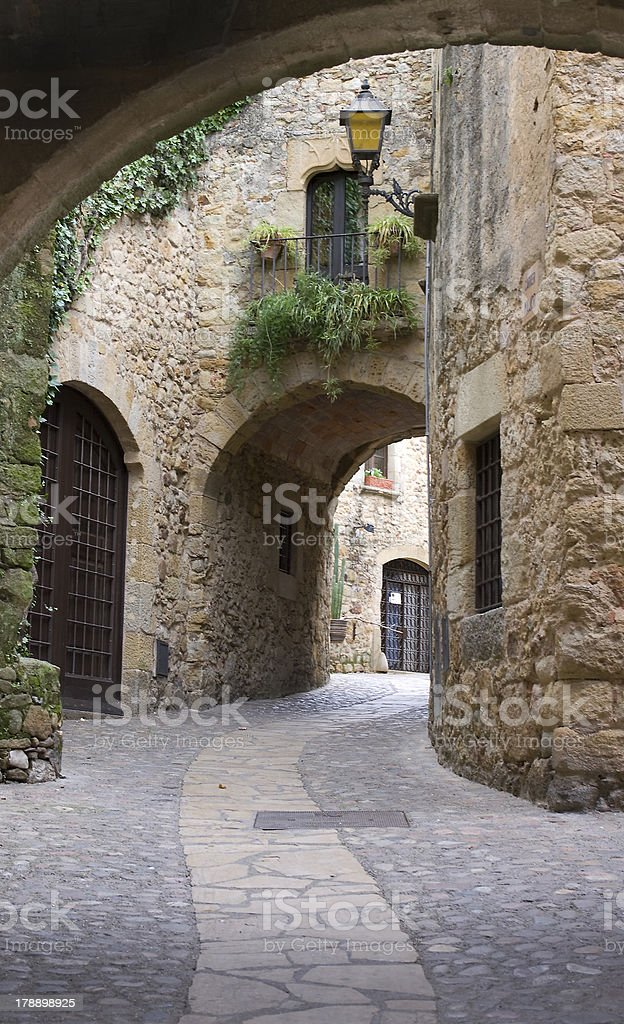 street in the village medieval of  Pals royalty-free stock photo