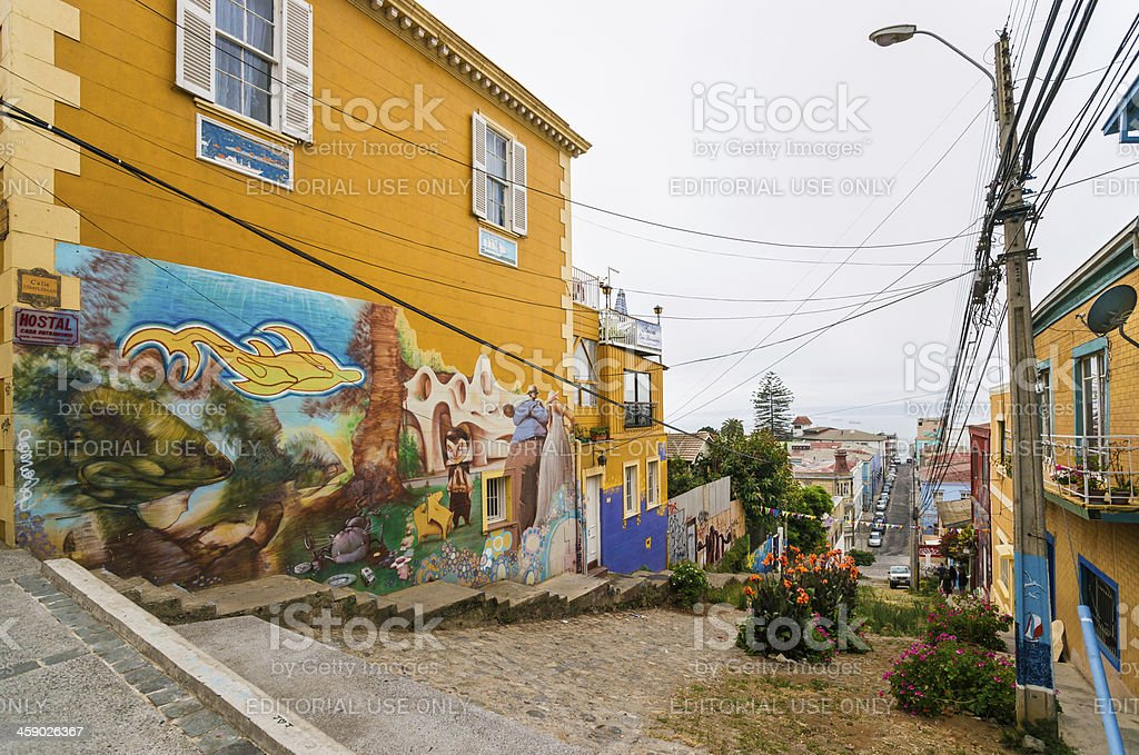 Street in Valparaiso and House Covered with Elaborate Graffiti stock photo