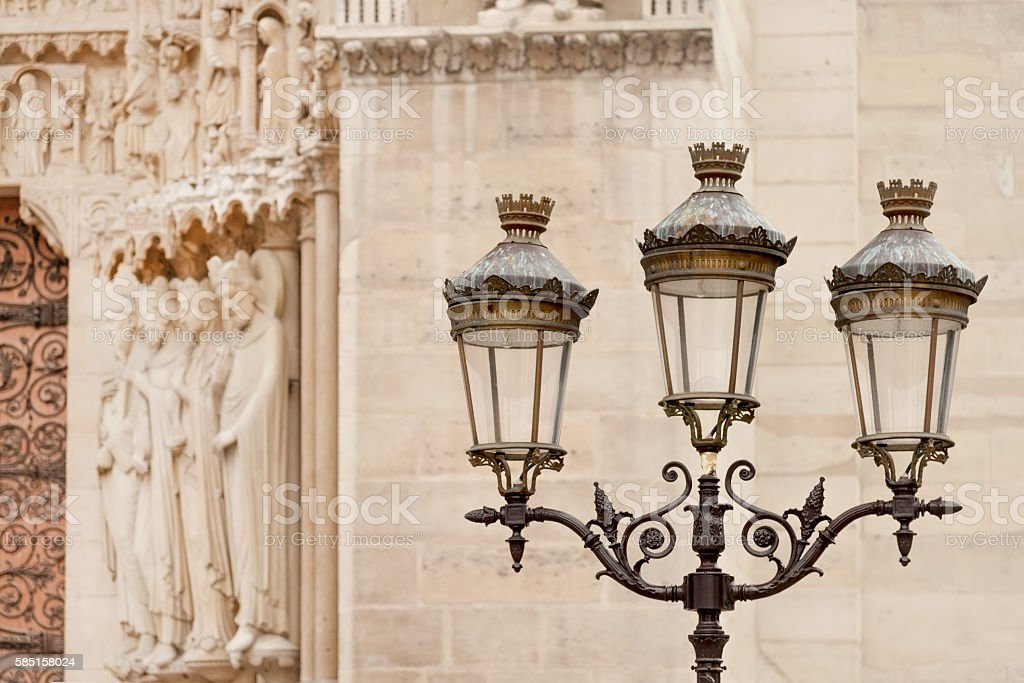 Street lamp by Notre Dame cathedral stock photo