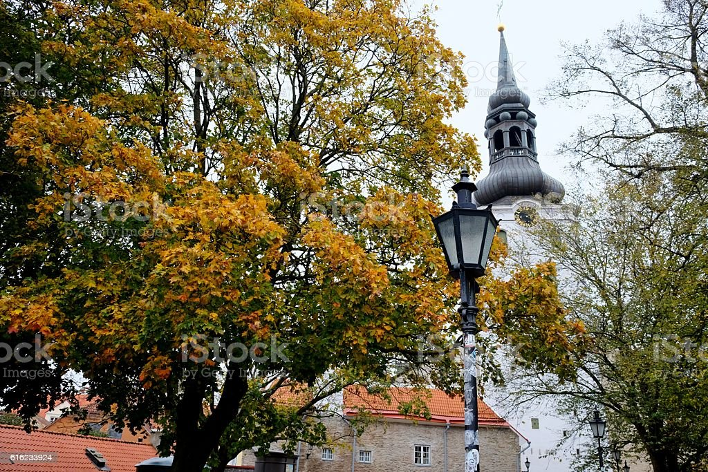 Street lamp near church stock photo