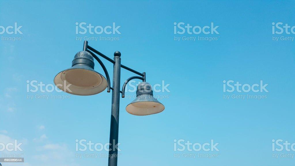 Street lamp on blue sky stock photo