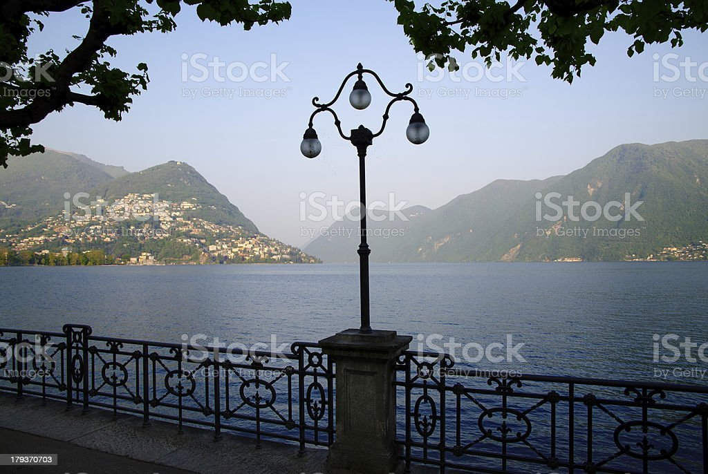 Street lamp on the lake front royalty-free stock photo