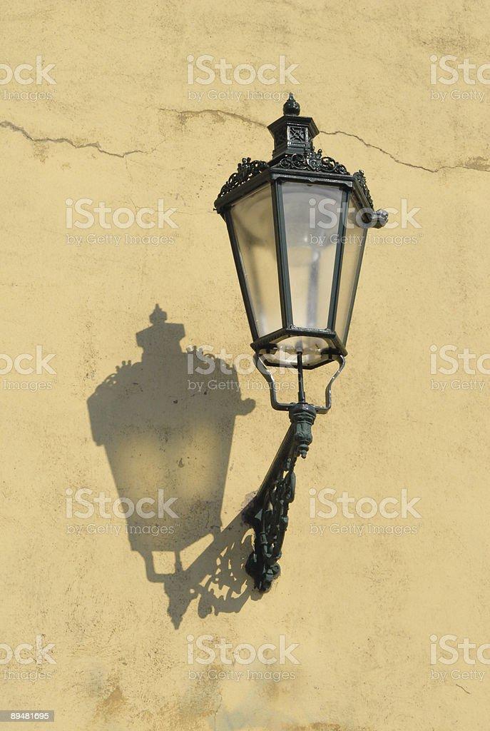 Street lamp on yellow wall, Prague, Czech Republic stock photo