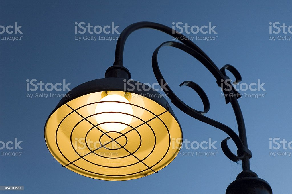 Street lamp shining royalty-free stock photo