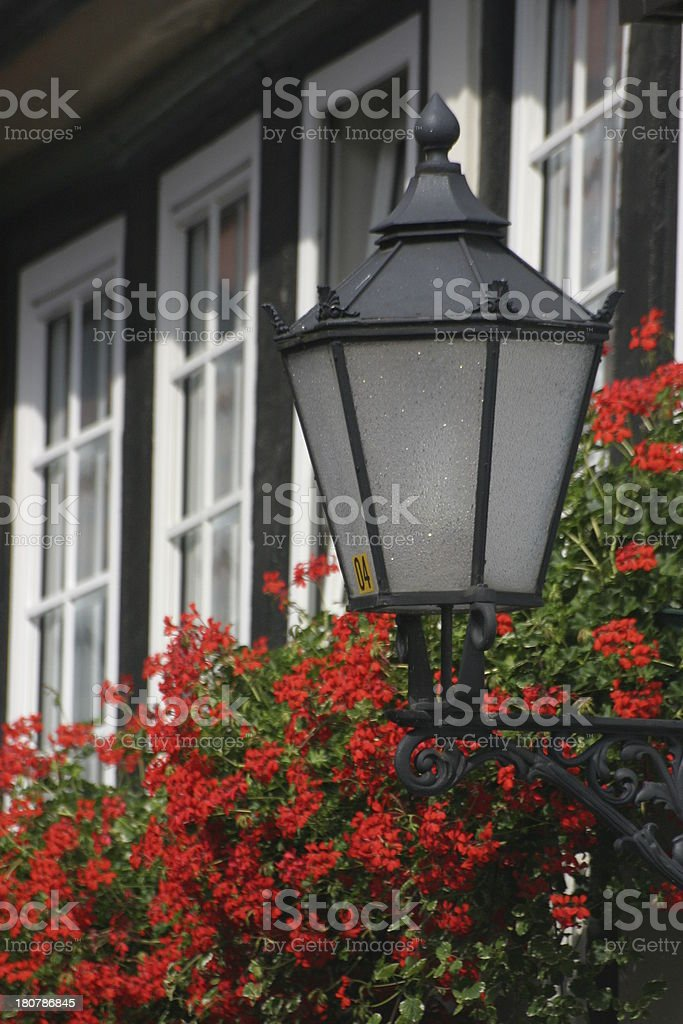 Street lamp with geraniums stock photo