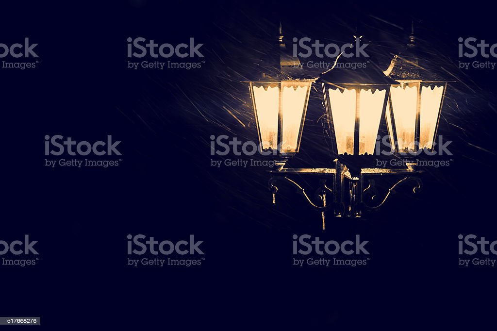 Street lamps in snowfall close up photo. Tinted photo stock photo
