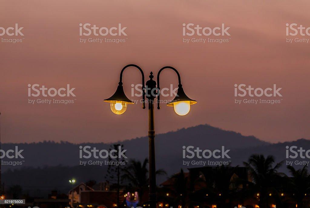 Street lamps  mountain background. stock photo