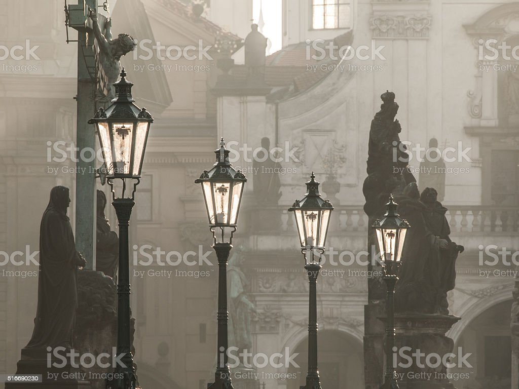 Street lamps on Charles bridge in the morning Prague stock photo