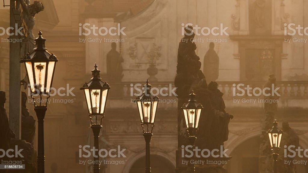 Street lamps on Charles bridge in the morning Prague stock photo