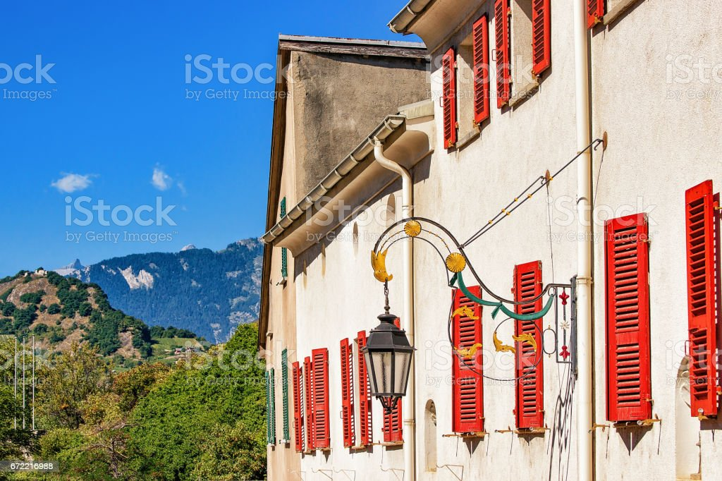 Street lantern and building architecture at Sion Valais Switzerland stock photo
