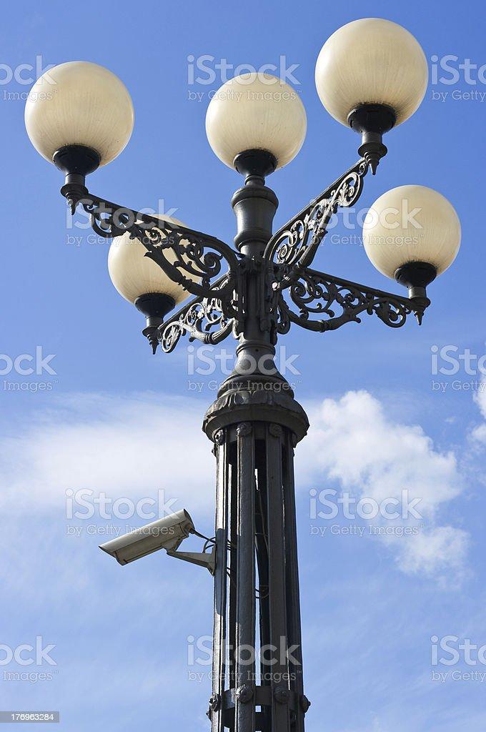 street lantern with security camera stock photo