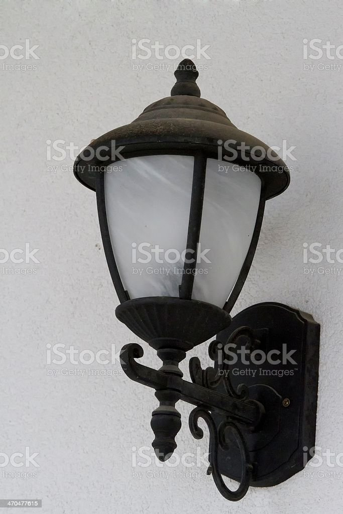 Street lanterns on the wall of a stone house royalty-free stock photo