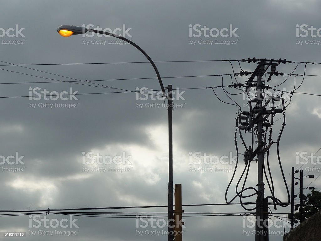 Street light and power lines stock photo