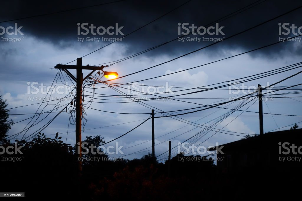 Street light at night with a stormy sky background stock photo
