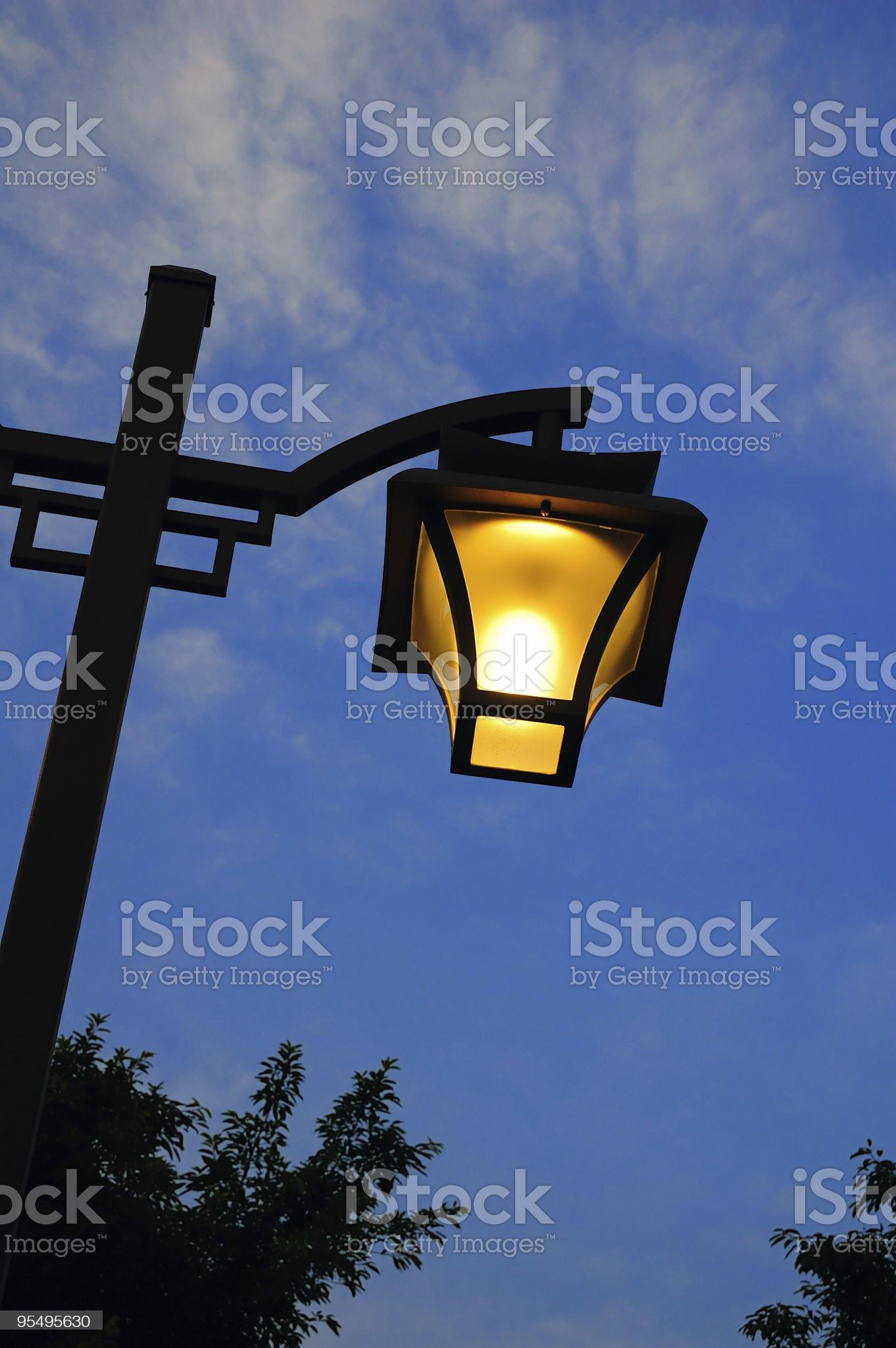 Street light at nightfall royalty-free stock photo