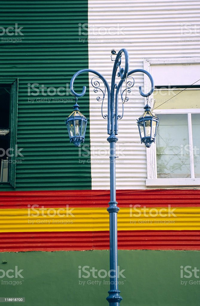 Street light in front of corrugated iron wall, La Boca stock photo