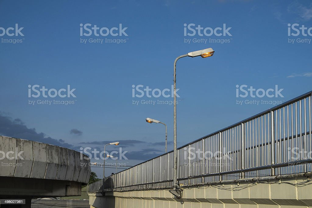 Street light pole with a blue sky background. royalty-free stock photo