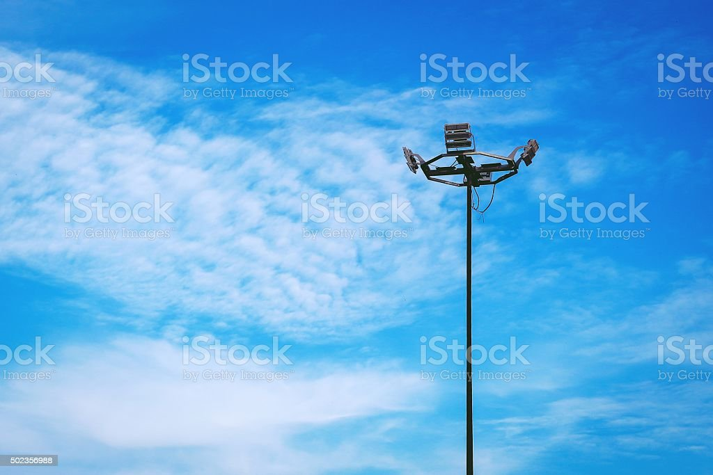 Street light with halogen lamp against blue sky stock photo
