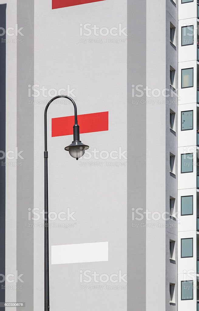 street light with plattenbau in background stock photo