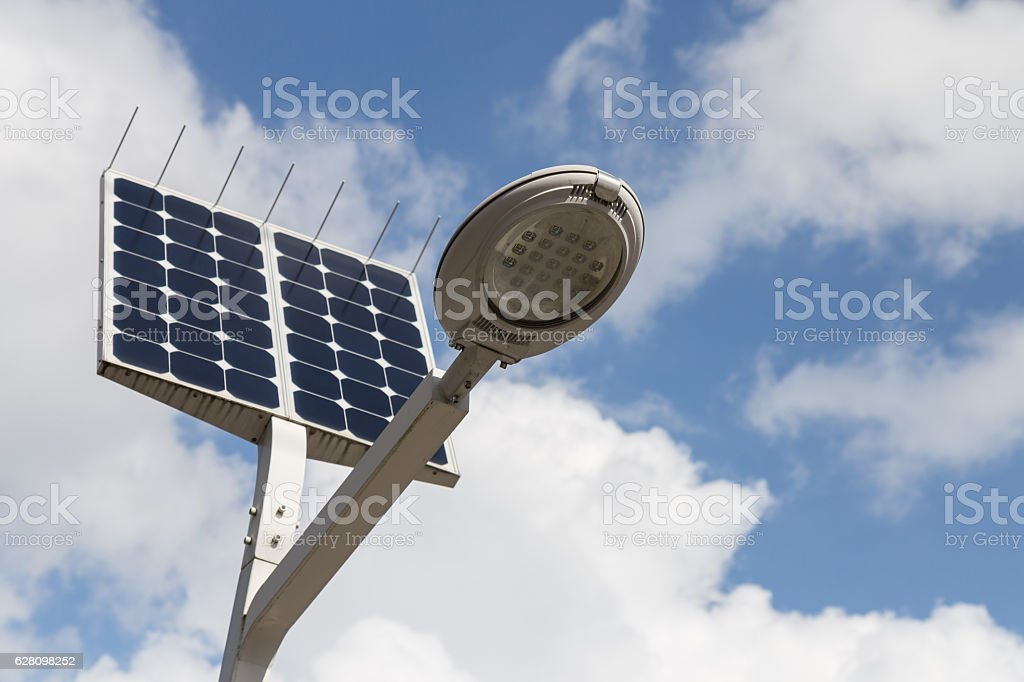 LED street light with solar cell and blue sky background stock photo