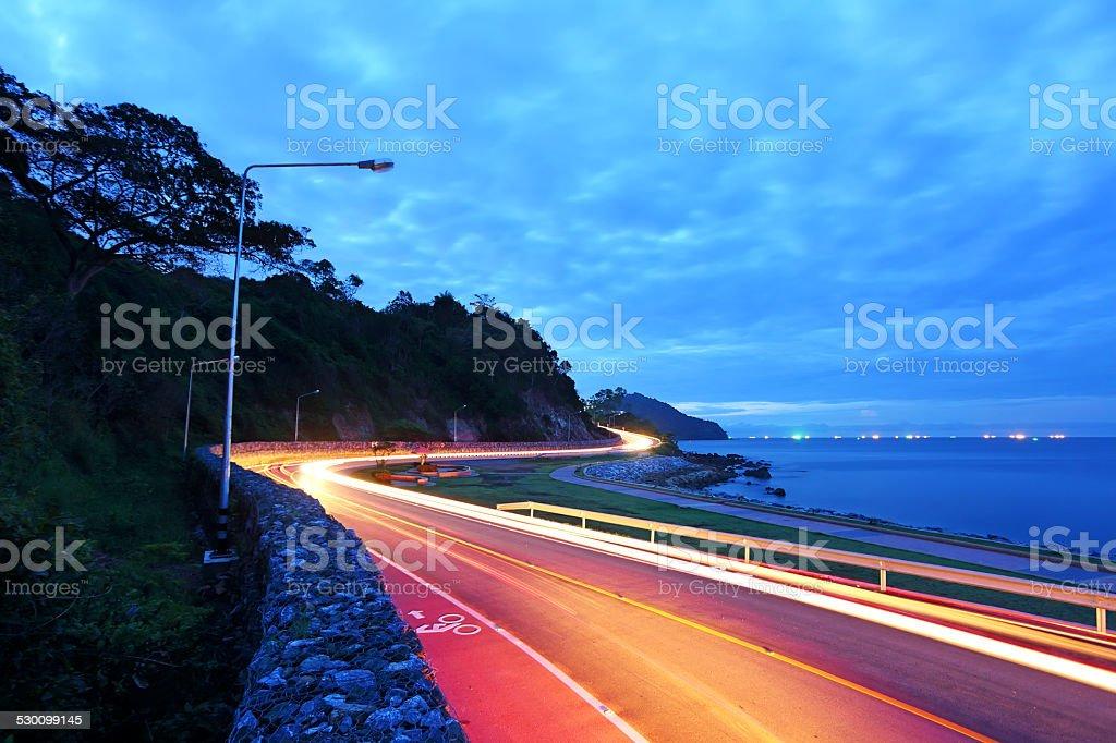 Street lights along the sea stock photo