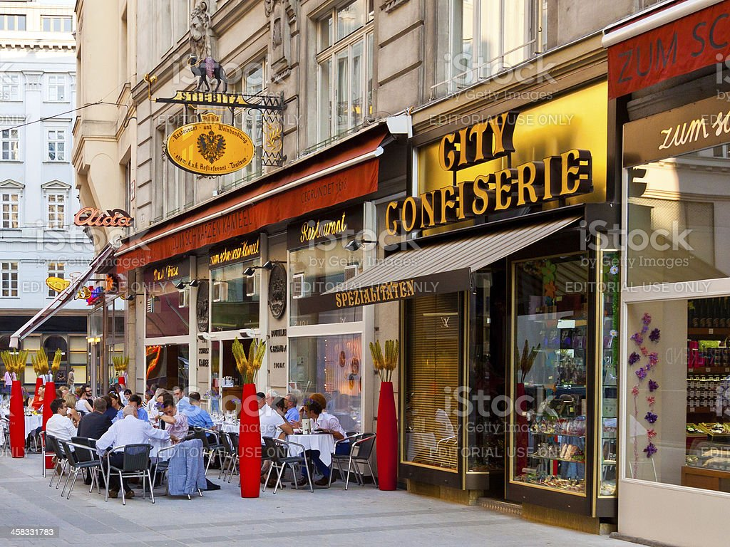 Street lined with Restaurants and Stores, Vienna. stock photo