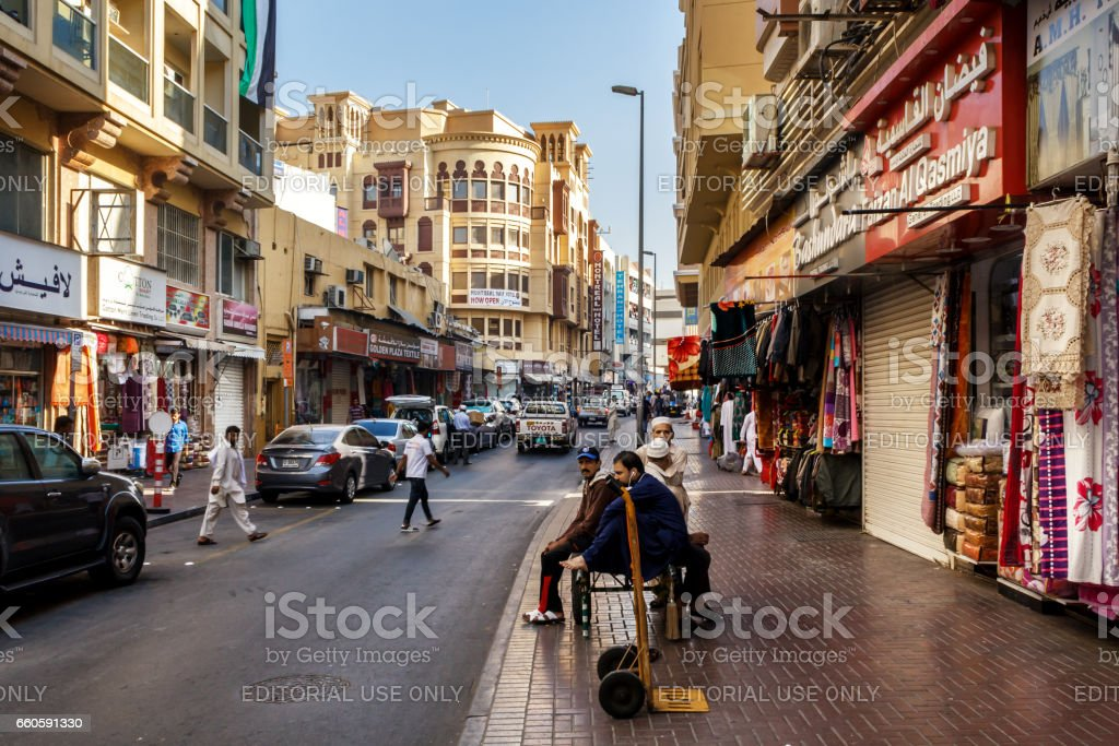 Street loaders are waiting for work on the streets of old Dubai stock photo