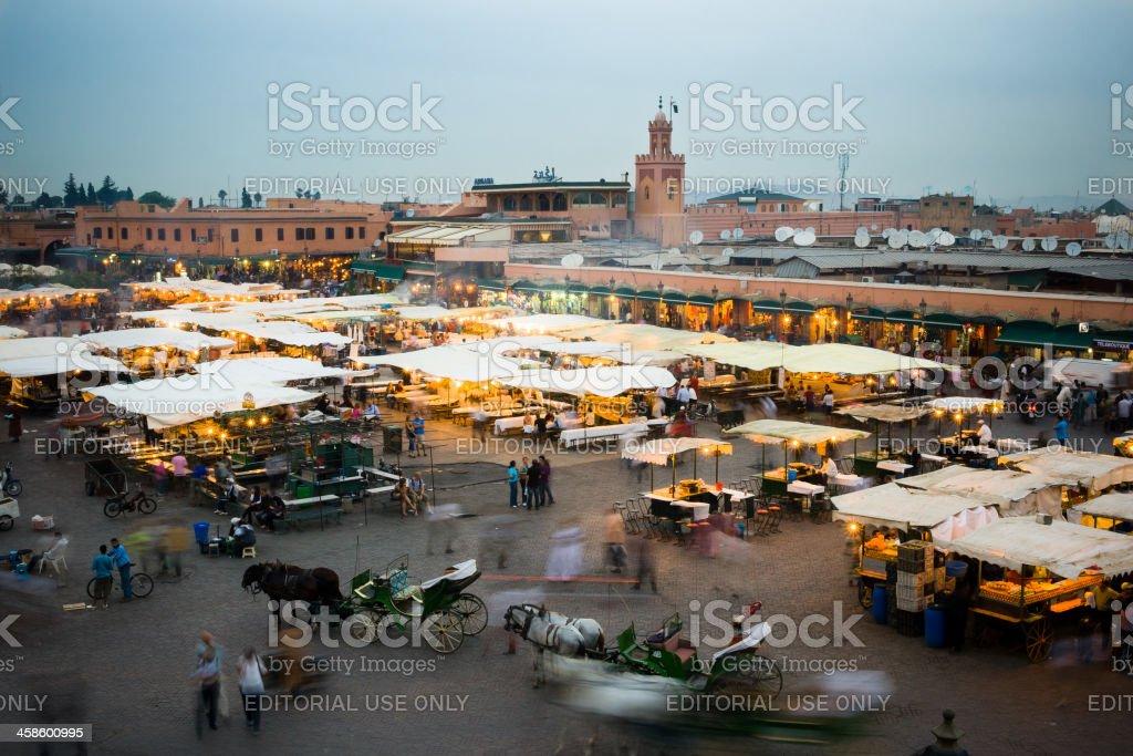 Street Market in Djemaa el Fna at Sunset, Marrakesh, Morocco royalty-free stock photo