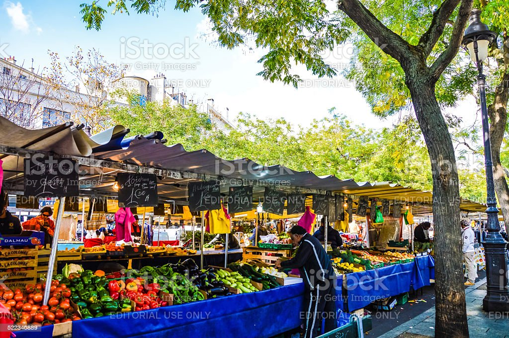 Street market in Paris. People walking and buying food stock photo