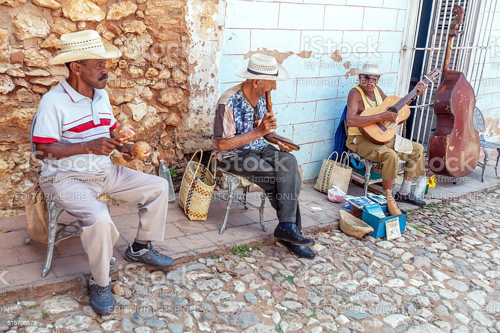 Street music band of four men, Trinidad, Cuba stock photo
