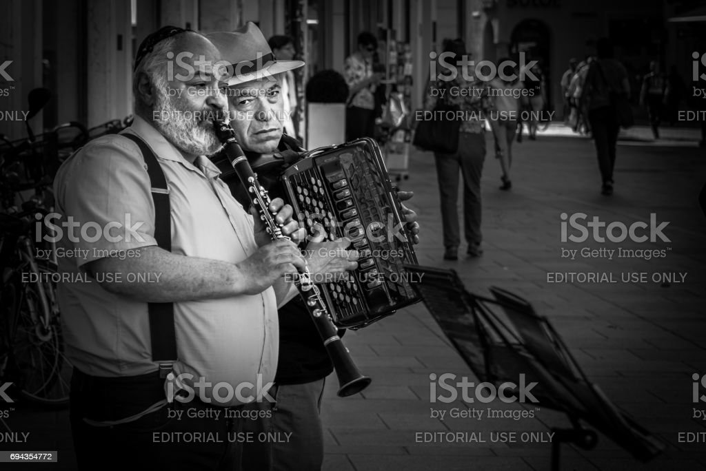 Street musician at the pedestrian zone in Regensburg stock photo
