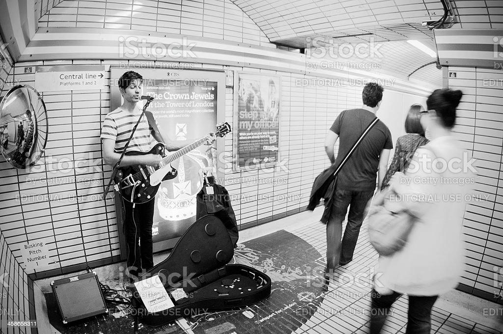 Street musician at Tottenham Court Road tube station, London stock photo