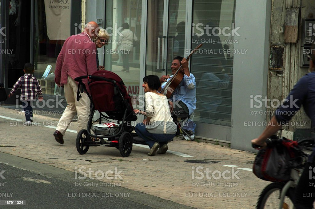 Street musician in action stock photo