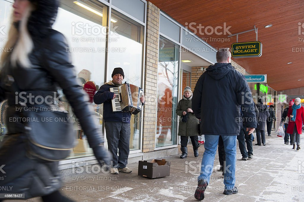 Street musician in winter setting stock photo