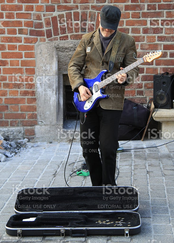 street musician is playing guitar outdoor in Krakow, Poland stock photo