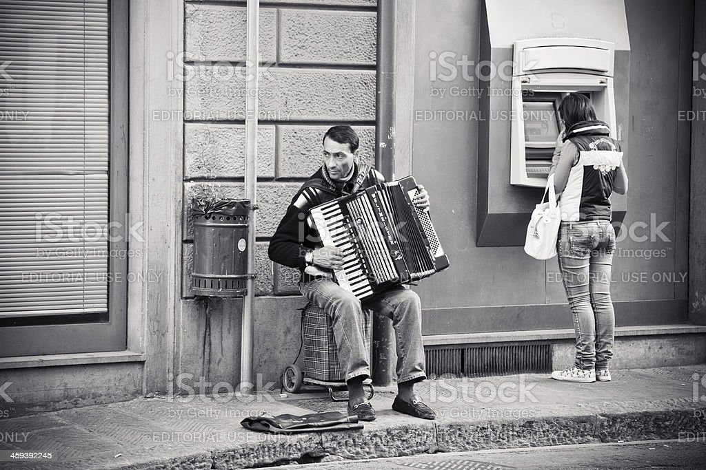 Street Musician Playing Accordion in Florence royalty-free stock photo