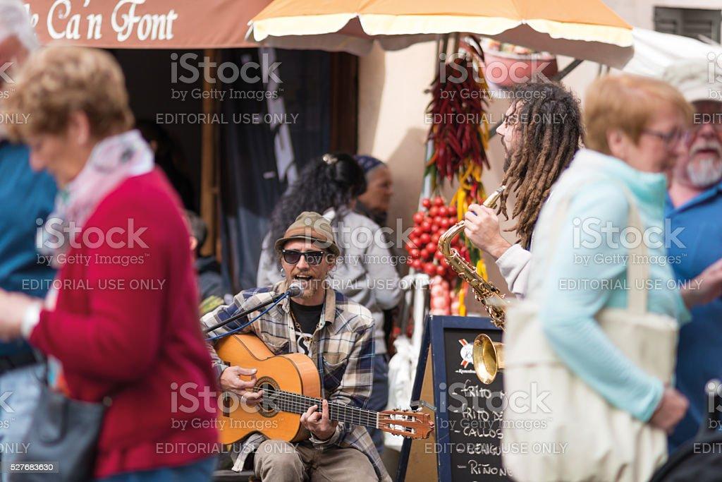 Street musician playing at city market day in Sineu Mallorca stock photo