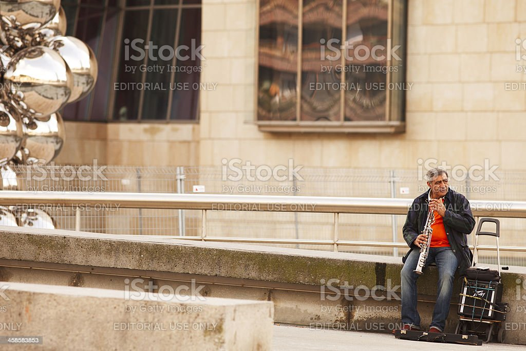 Street musician playing clarinet in Bilbao stock photo