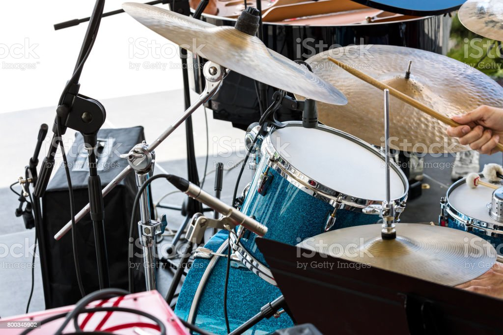 street musician playing drums with drumsticks in his hands stock photo