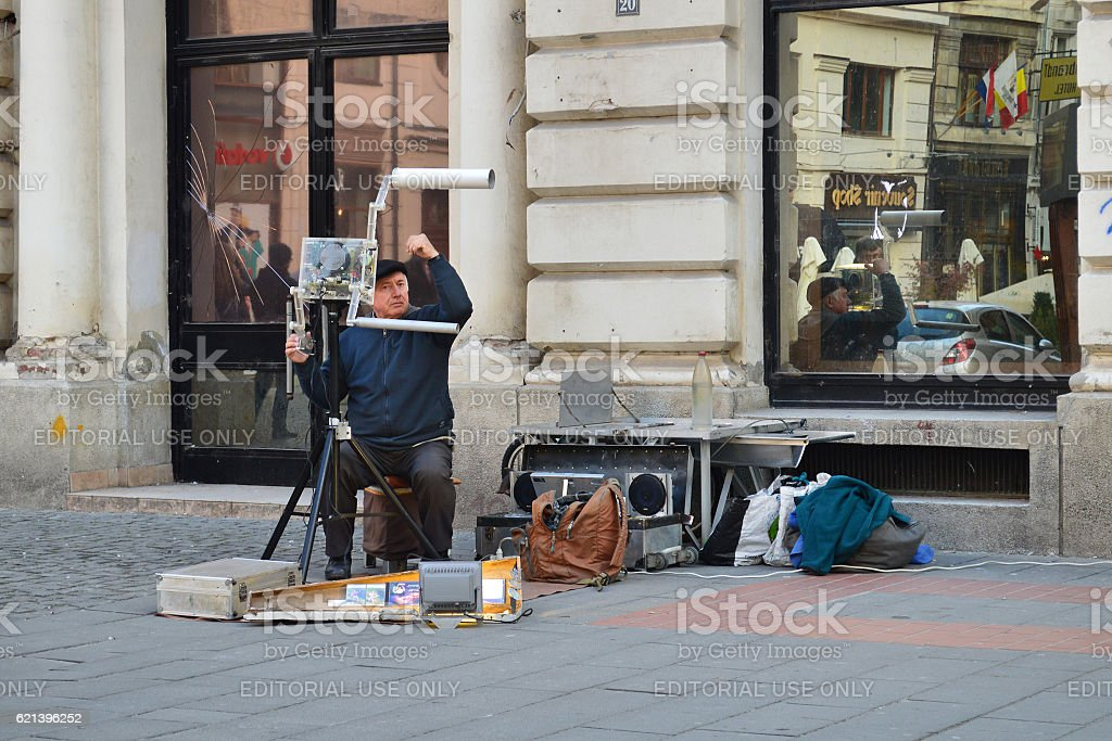 Street musician playing electronic oscillator stock photo