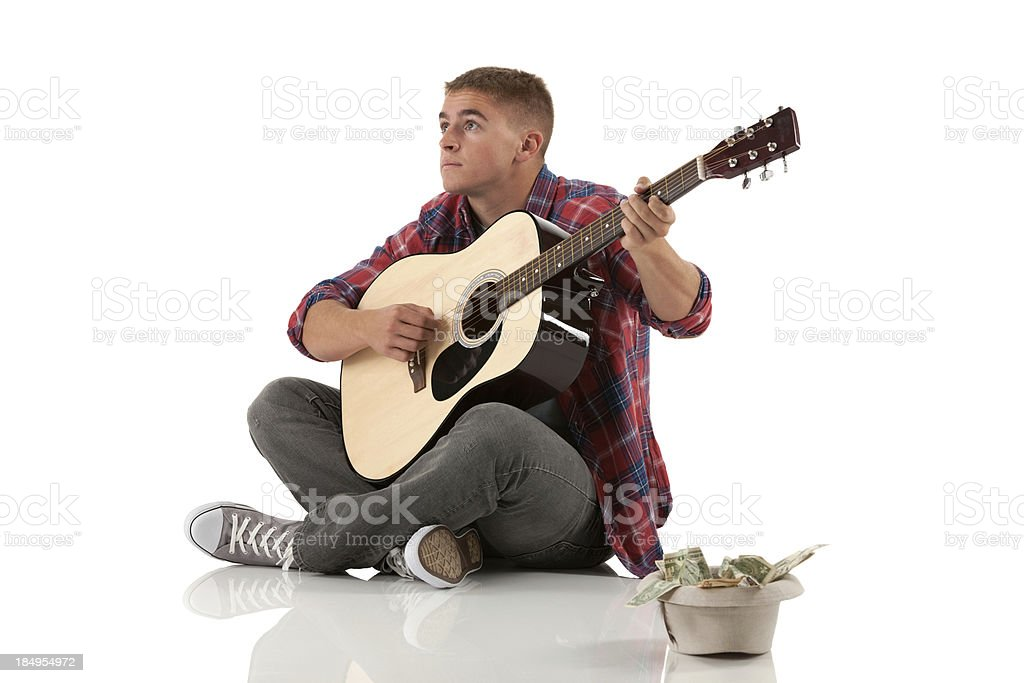 Street musician playing guitar royalty-free stock photo