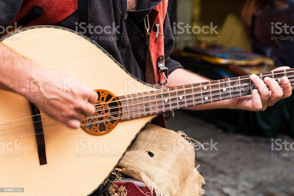 street musician playing stock photo