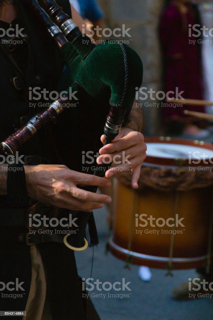 street musician playing stock photo
