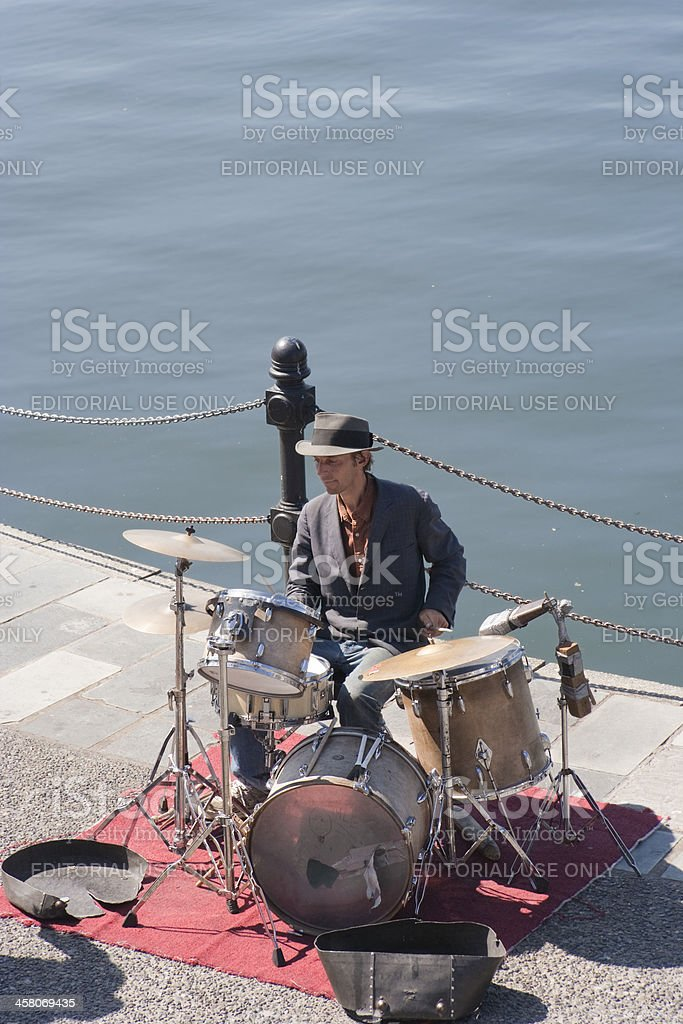 Street Musician playing the drums royalty-free stock photo