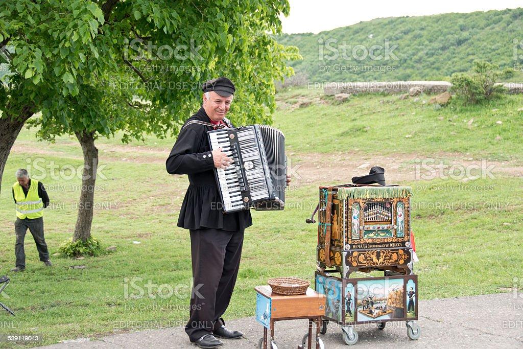 Street musician plays the accordion in Mtsketa, Georgia. stock photo