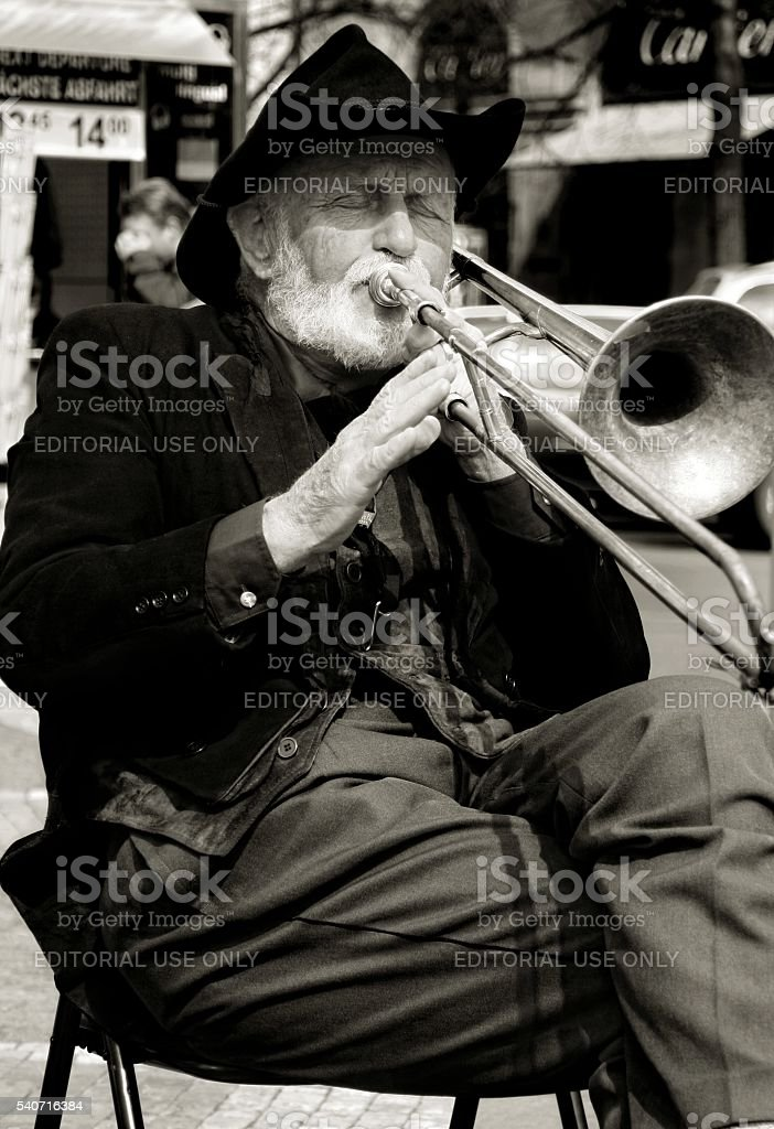 Street musician plays trombone Prague Czech Republic Black and White stock photo