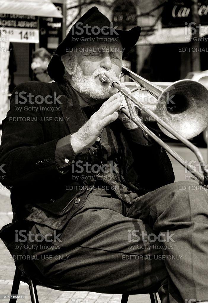Street musician plays trombone Prague Czech Republic Black and White stock photo