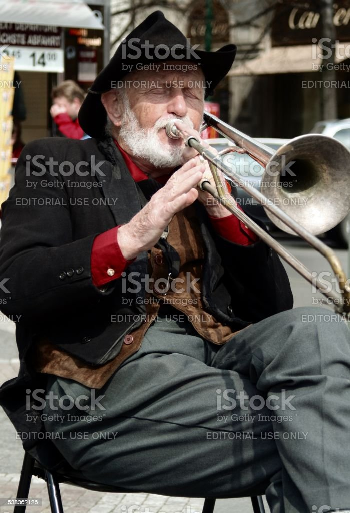 Street musician plays trombone Prague Czech Republic stock photo