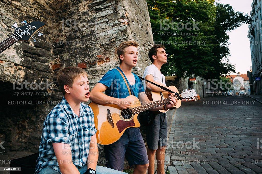 Street Musicians Buskers Play Evening Near Famous Viru Gate stock photo
